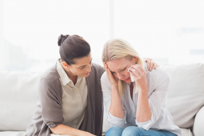 therapist giving comfort to woman