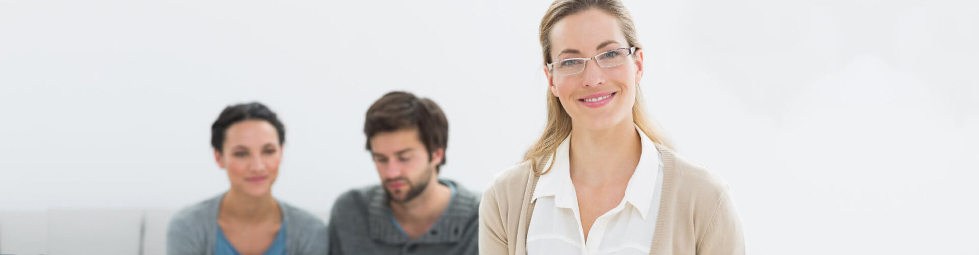 female counselor smiling with the couple at her back
