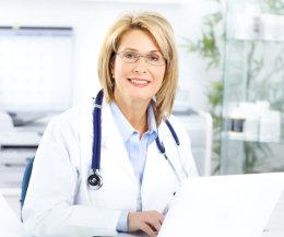 nurse with stethoscope smiling