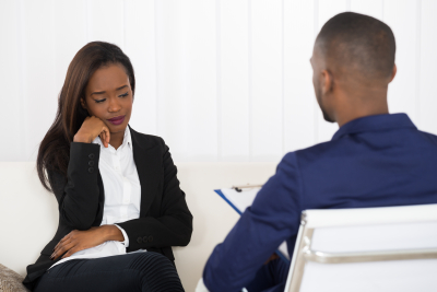 woman having a session with his therapist